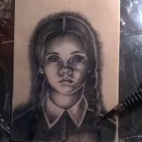 Wednesday Addams tattoo on practice skin by MissMisfit13