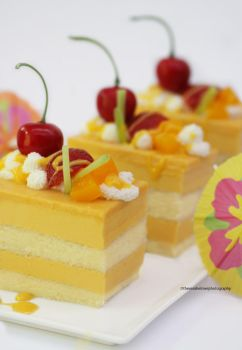 Tropical Mango Mousse Cake by theresahelmer