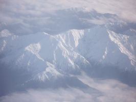 Alps and clouds by RealmKnight