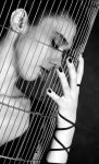 Caged... by aNgElIk-SiLeNcE