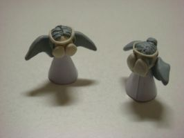 Two Weeping Angels by The-Sorrowful-One