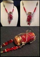 Health Potion Necklace by NikidaEve