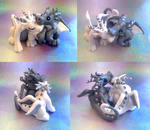 Silver and White Dragon Couple by Alexandrite-Dragons