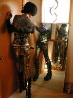 Bronze-jeaned and corseted boy by dude-girl