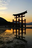 Torii in front of Itsukushima Temple on Miyajima by mkuegler