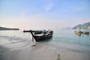Boats on the beach by drewhoshkiw