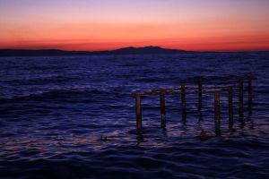 afterglow sea and broken stage by matricaria72