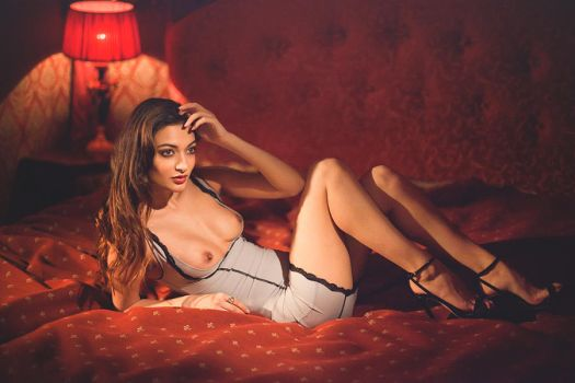 In a red room by NayaModel
