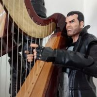 The Punisher harpin' away. by OwossoHarpist