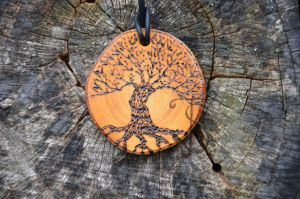 Black tree white tree round pendant by sleepyhamsteri