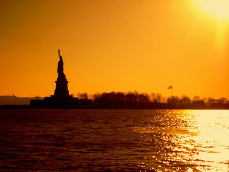 Sunset over Statue of Liberty by Xylaphonic