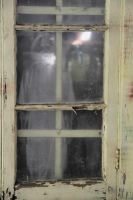 The Spook in the window by Bluebuterfly72
