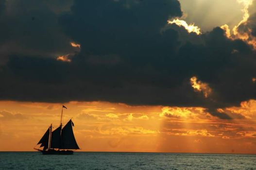 pirate ship at sunset by shutterblade
