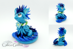 Otis the Forget-me-not griffin by CalicoGriffin