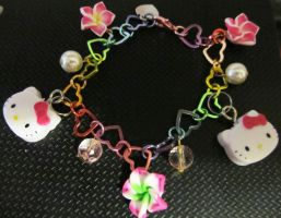 hello kitty charm bracelet by AnaInTheStars